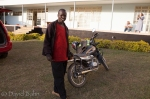 Evangelist Joshua with motorbike given him by St. John