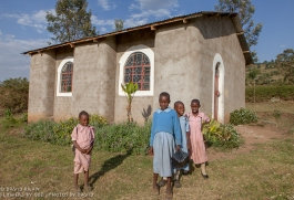 Four young girls stand outside a small Lutheran Church building outside of Kilgoris, Kenya. March 2015